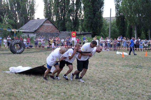 Змагання для мужніх – у Білозерську відбувся фестиваль «Козацькі розваги» 2019, фото-1